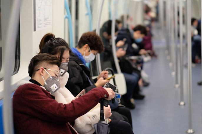 People on a subway with surgical masks on in China