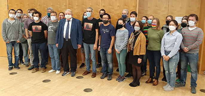 Reinhard Genzel with his team in Germany, all wearing masks