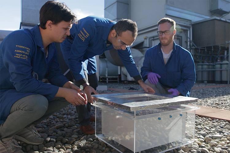 Markus Kalmutzki, Farhad Fathieh and Eugene Kapustin set up the water harvester for tests on a rooftop on the UC Berkeley campus