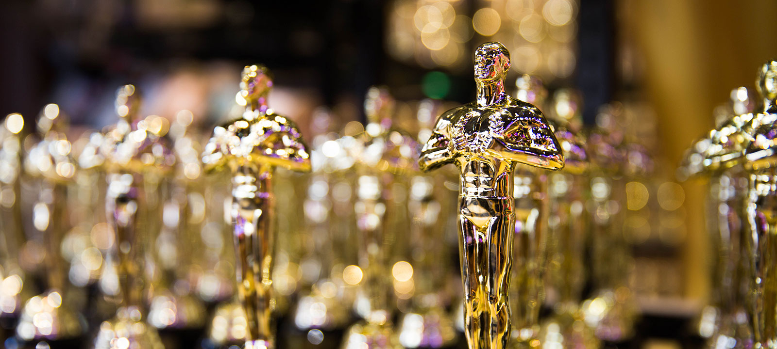 Oscar statuettes in a row