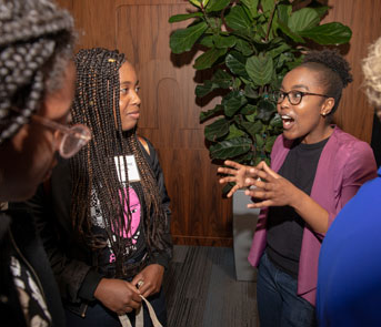 UCLA's Nyasha Maforo chats with Black Girls code student Adore Whitfield