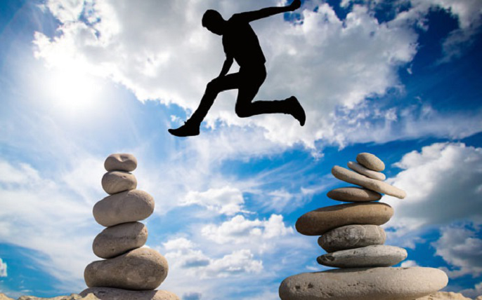 A man jumping over stones