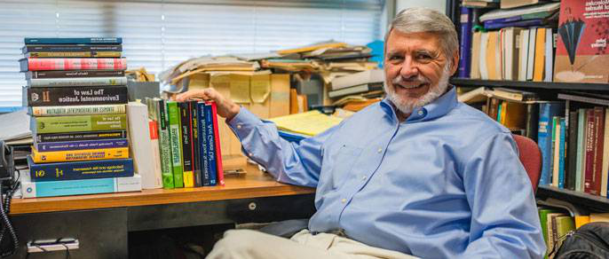 Carl Cranor with his books