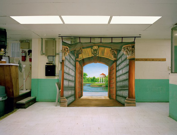 Landscape painting hung in a prison hallway